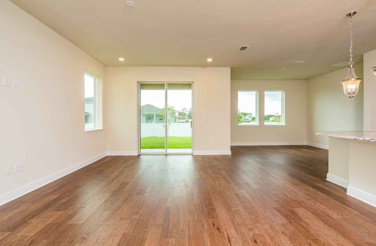 Sea Breeze quick move-in Great room with sliding glass door to lanai