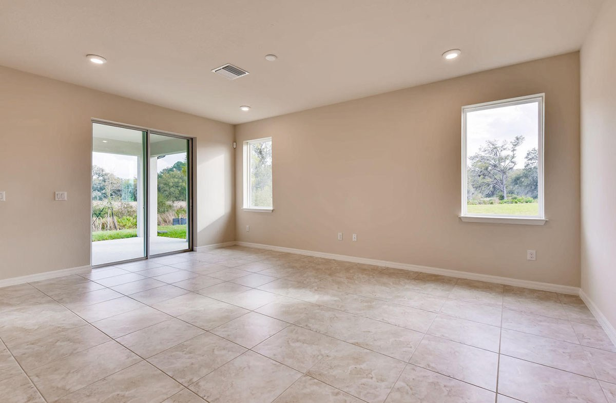 Sea Breeze quick move-in Open great room with sliding glass door to lanai