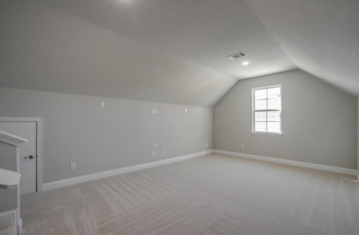 Aberdeen quick move-in media room with carpet and vaulted ceilings