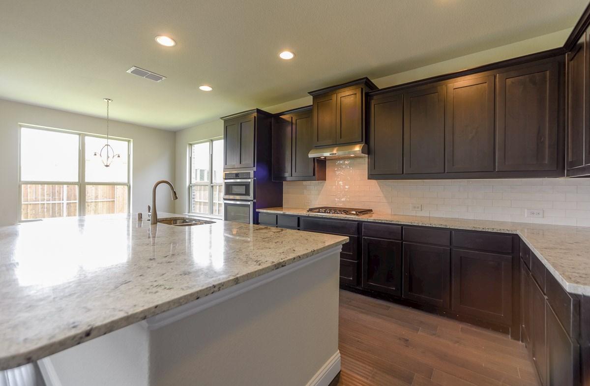 Trinity quick move-in kitchen includes granite kitchen island