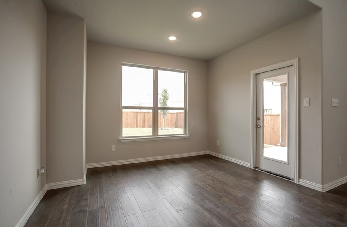 Brookhaven quick move-in cozy breakfast nook with door to covered patio