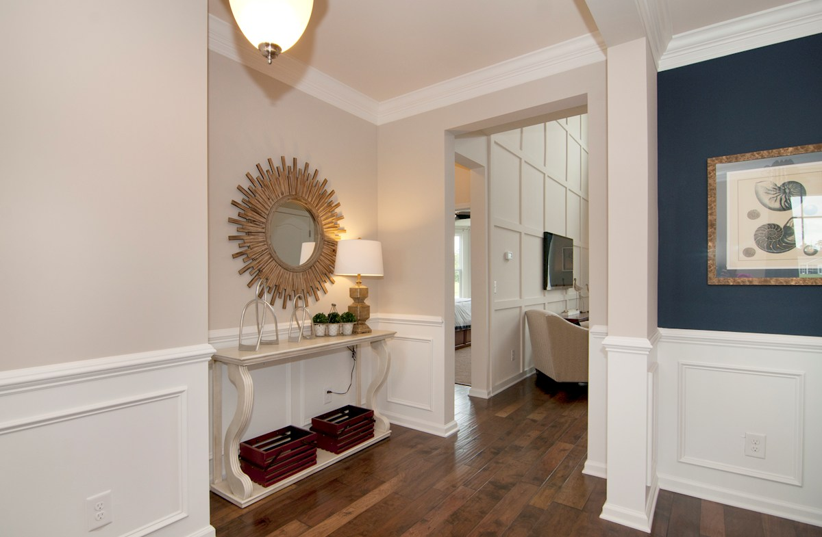Cameron Village Millbrook foyer features hardwoods and elegant trim