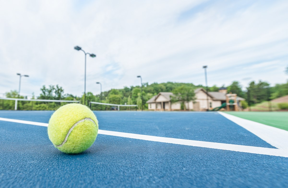 manicured tennis courts
