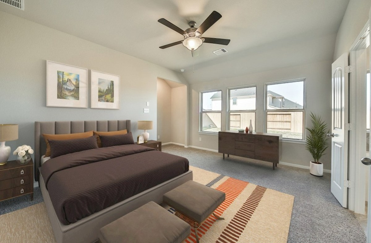 Villages at Harmony Hickory master bedroom with carpet and ceiling fan