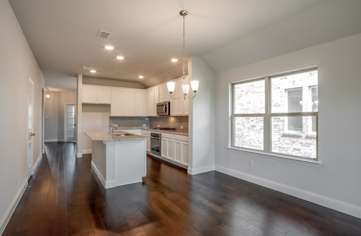 Millbrook quick move-in kitchen includes white cabinets and wood flooring