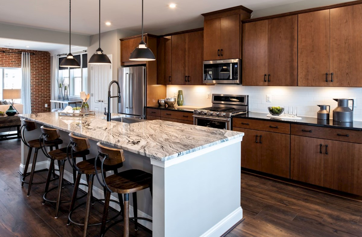 Riverwalk at Crofton Condos Taylor Taylor kitchen featuring granite and stainless steel