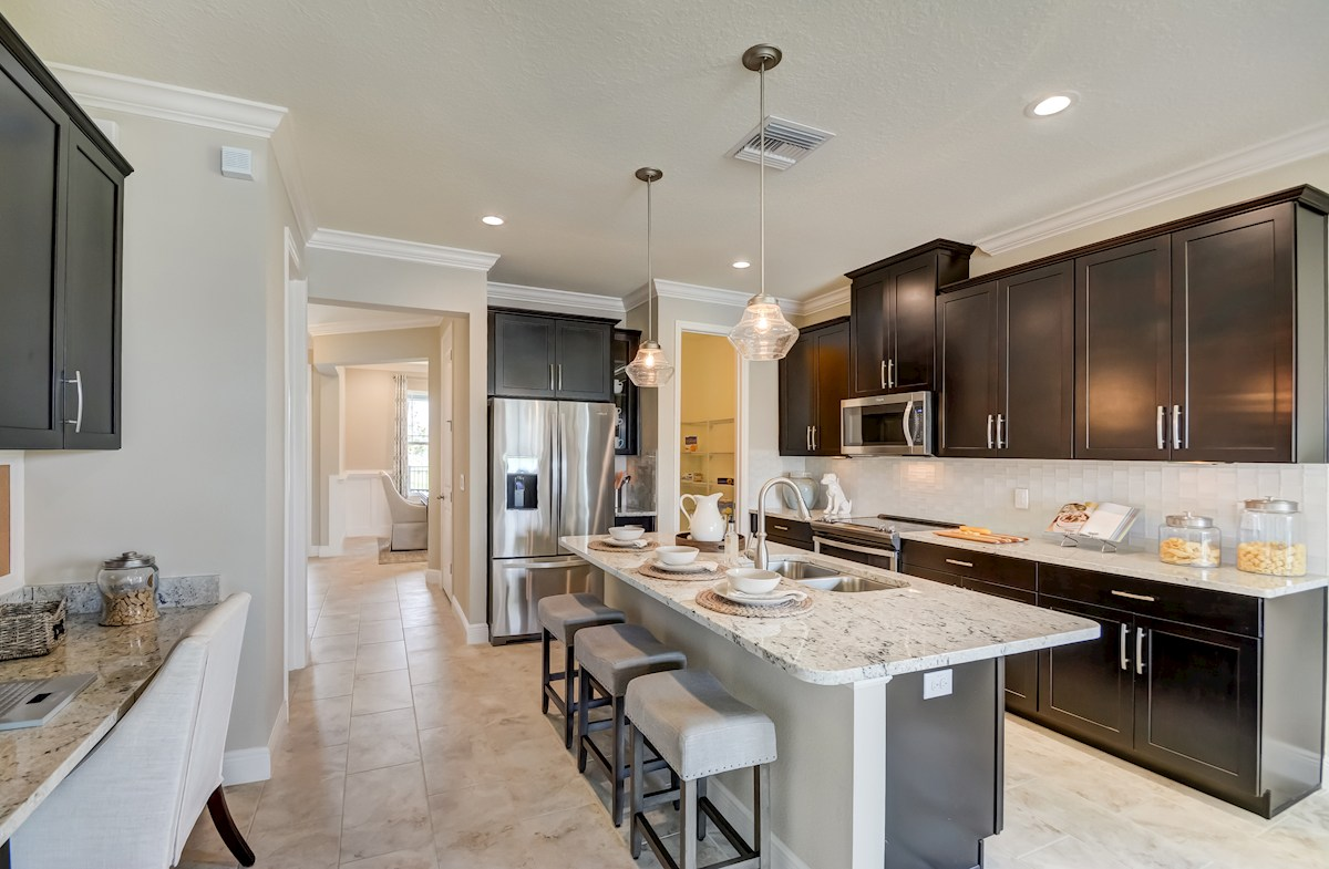 The Reserve At Pradera St Augustine II Kitchen With Center Island And Granite  Countertops