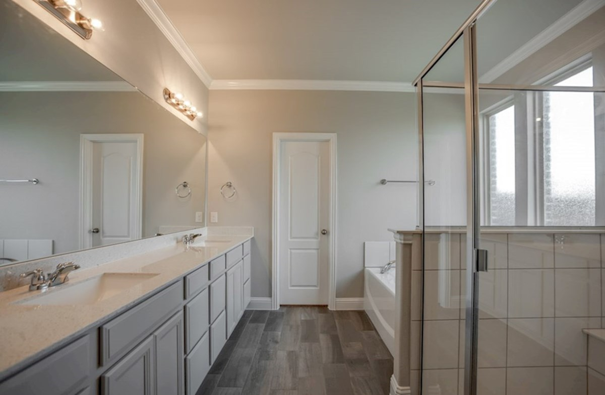 Summerfield quick move-in master bathroom with soaking tub and walk-in shower