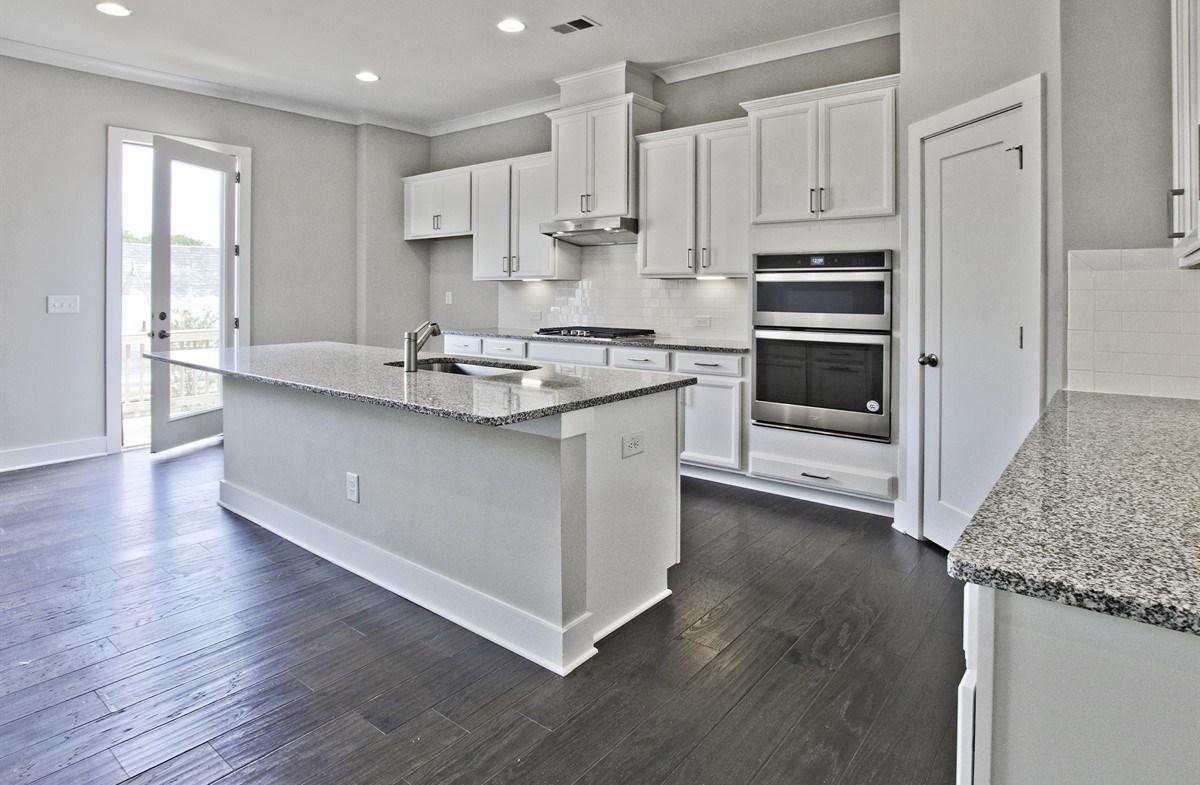 Callahan II quick move-in Kitchen with granite countertops