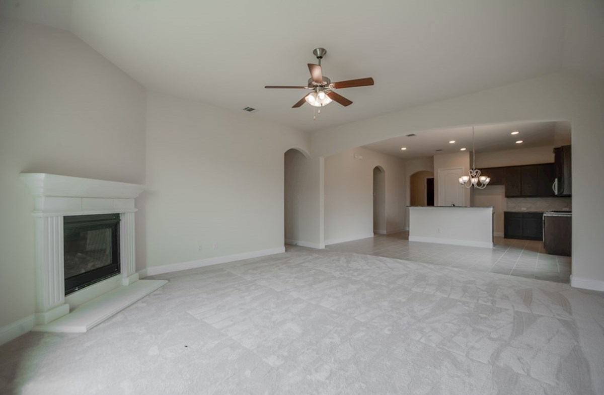 Silverado quick move-in open great room with carpet and ceiling fan