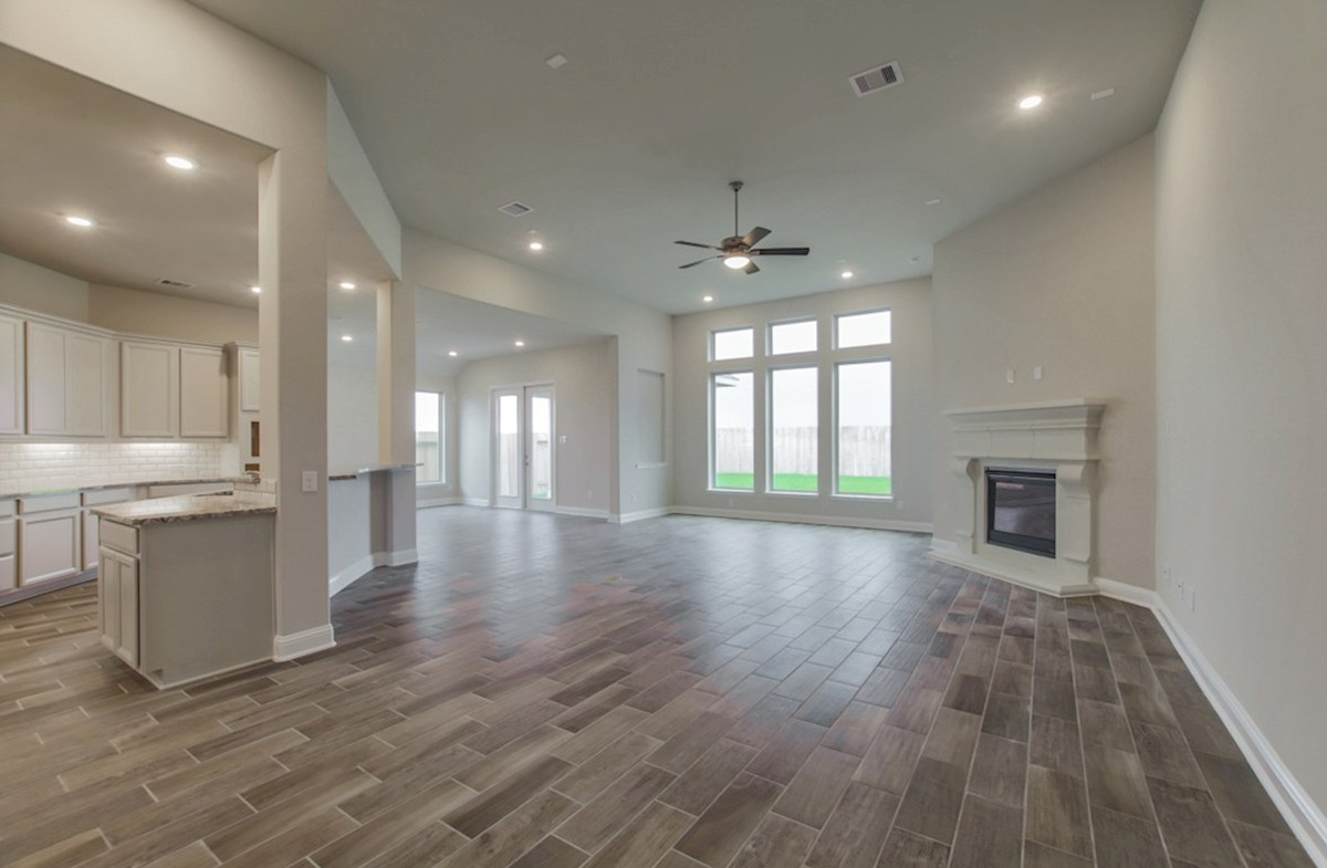 Fredericksburg quick move-in great room with stone fireplace and tile flooring