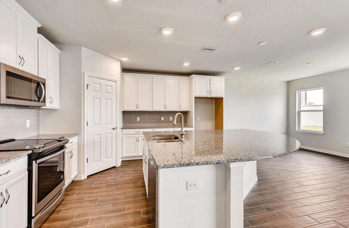 Cypress Pointe quick move-in Kitchen with a large center island and white cabinets
