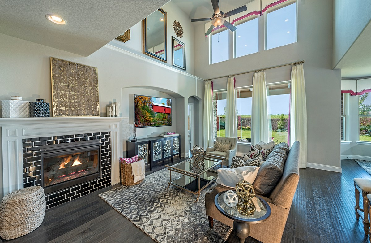 great room features two-story ceilings