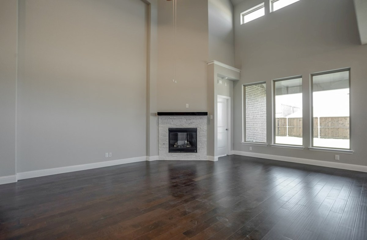Summerfield quick move-in Summerfield great room with fireplace and large windows