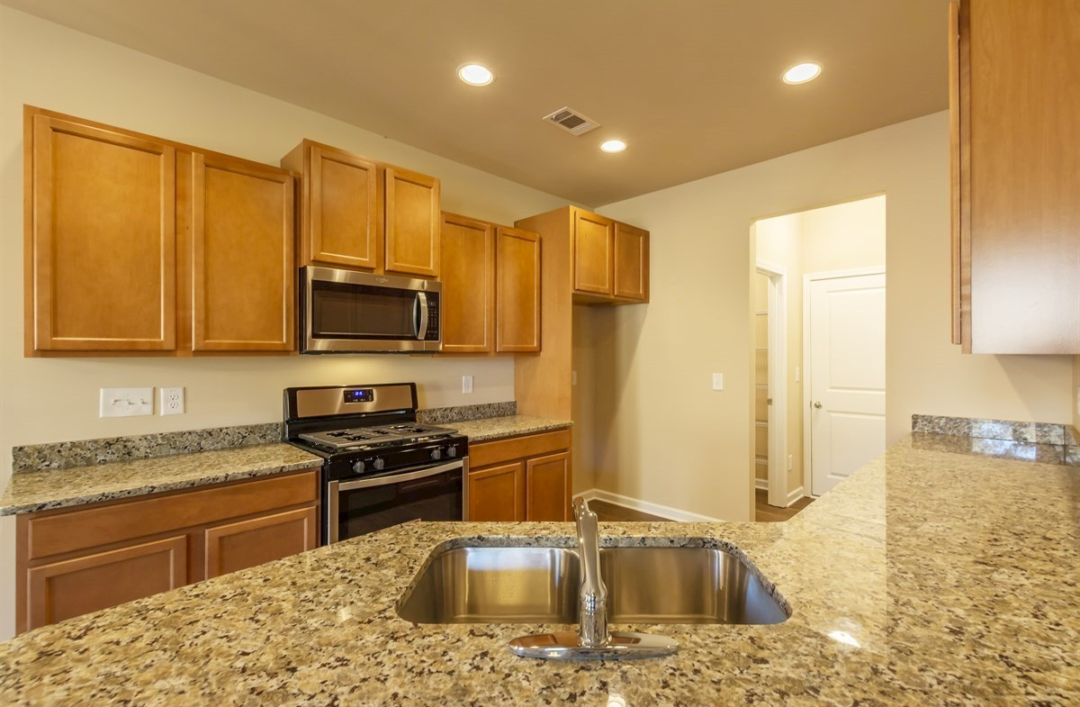 Rabun quick move-in Spacious kitchen with granite countertops
