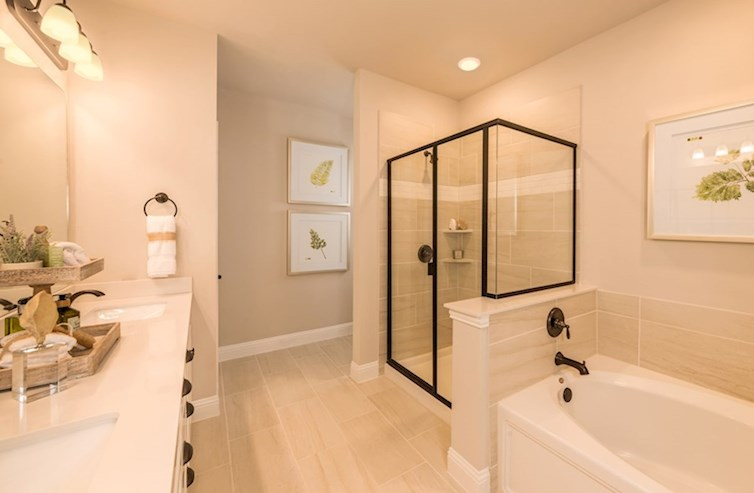 Gatherings® at Westview Wiltshire master bathroom with double sinks, tub and shower