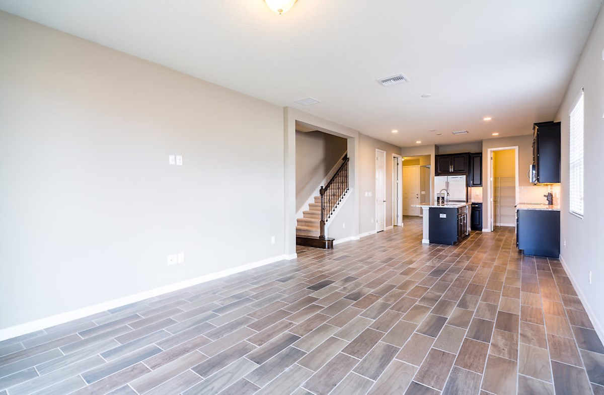 St. Augustine III quick move-in Family room featuring wood-look tiles