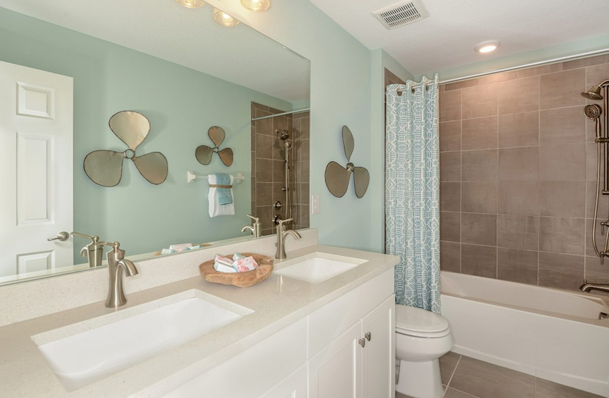Reserve at Citrus Park Lucia Bay Secondary bathroom with dual sinks and shower with tub