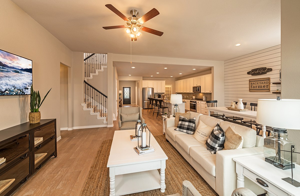 great room with hardwood floors and ceiling fan