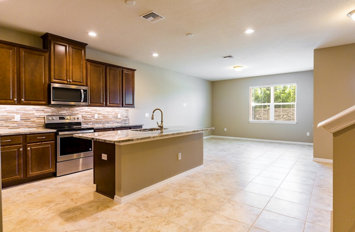 Champlain quick move-in LLR TH open kitchen and great room with tile flooring