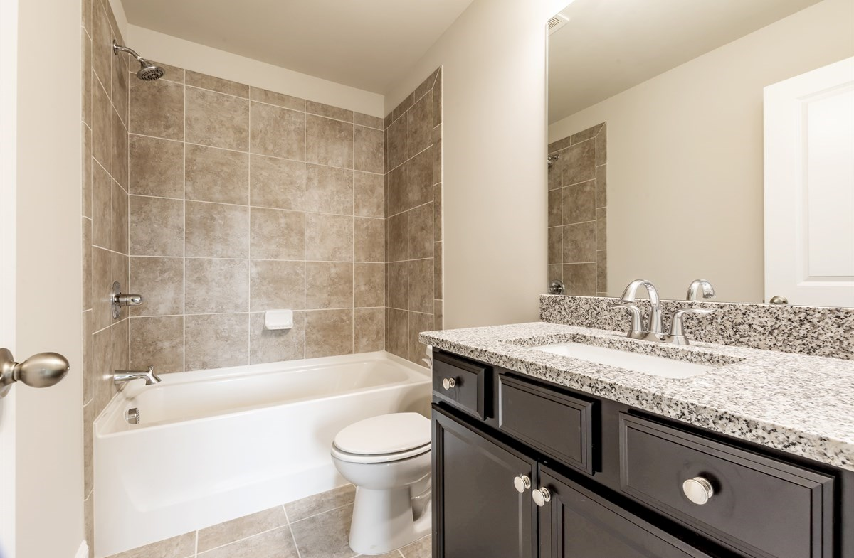 Callaway quick move-in Secondary Bathroom with granite countertops