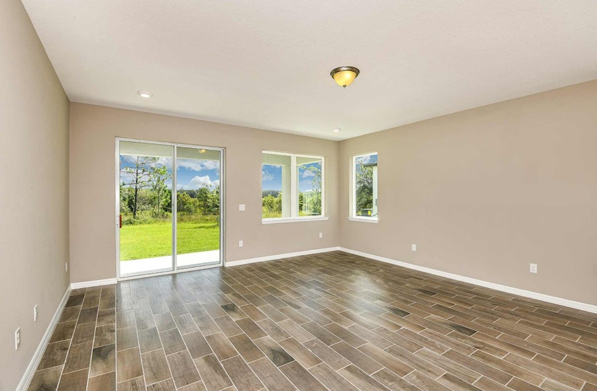 Shoreline quick move-in Great room with access to lanai and wood-look tile
