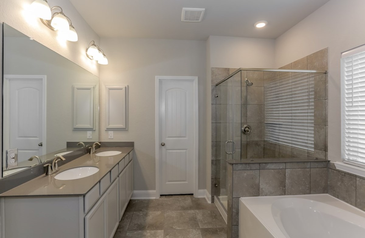 Southwinds Berkshire master bathroom with double sinks and tile flooring