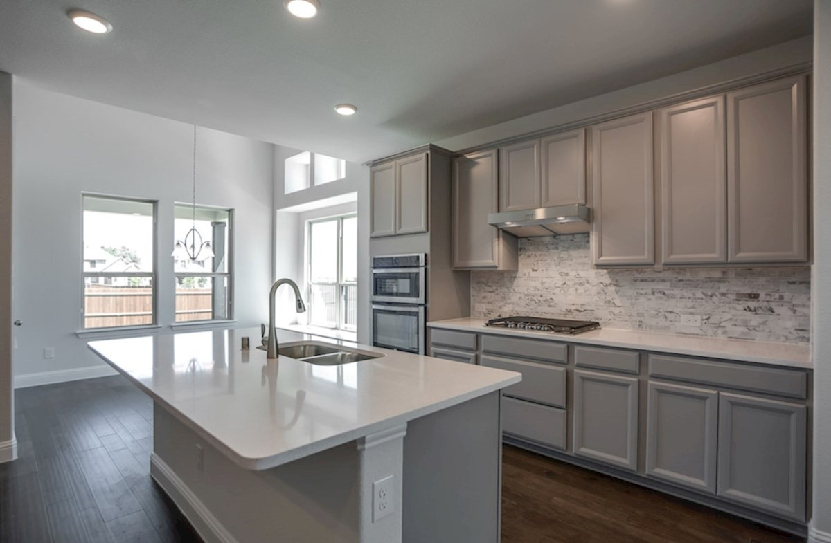 Richland quick move-in kitchen with white island and grey cabinets