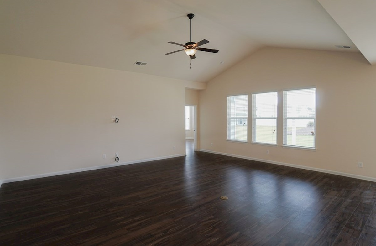 Valleydale quick move-in great room features vaulted ceilings