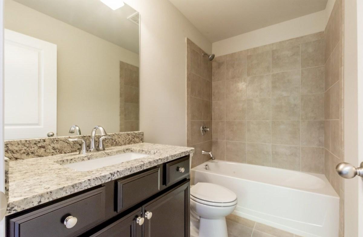 Preston quick move-in Secondary Bathroom with granite countertops