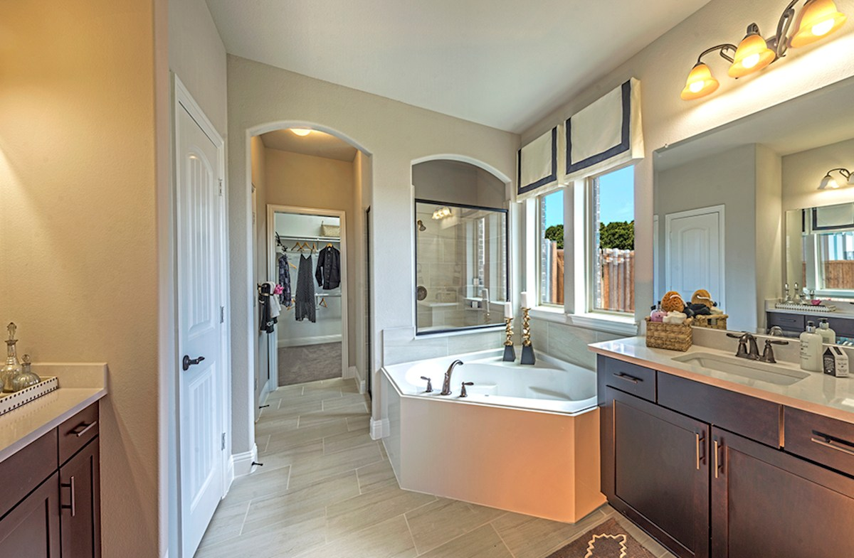bathroom with oversized tub and walk-in shower