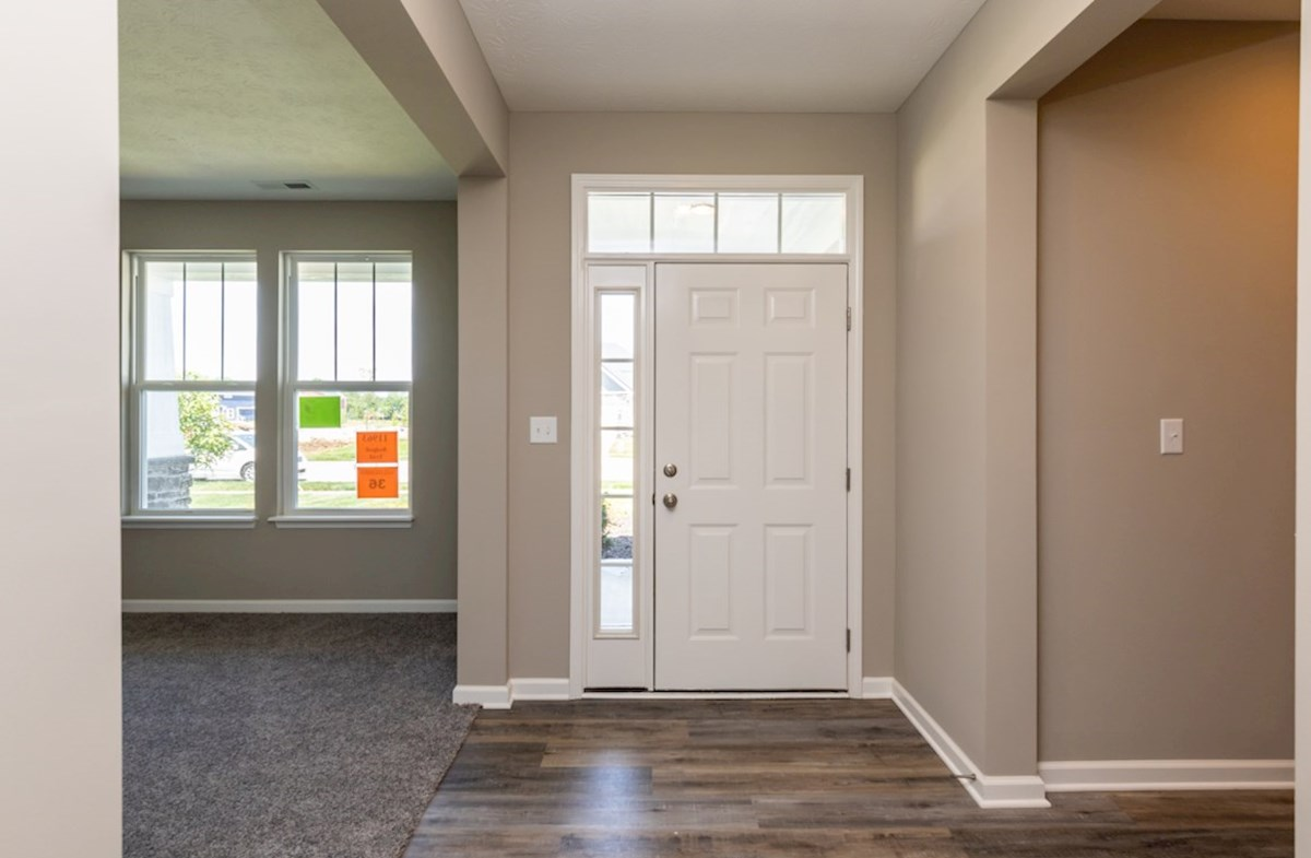 Hamilton quick move-in open foyer with door and side light