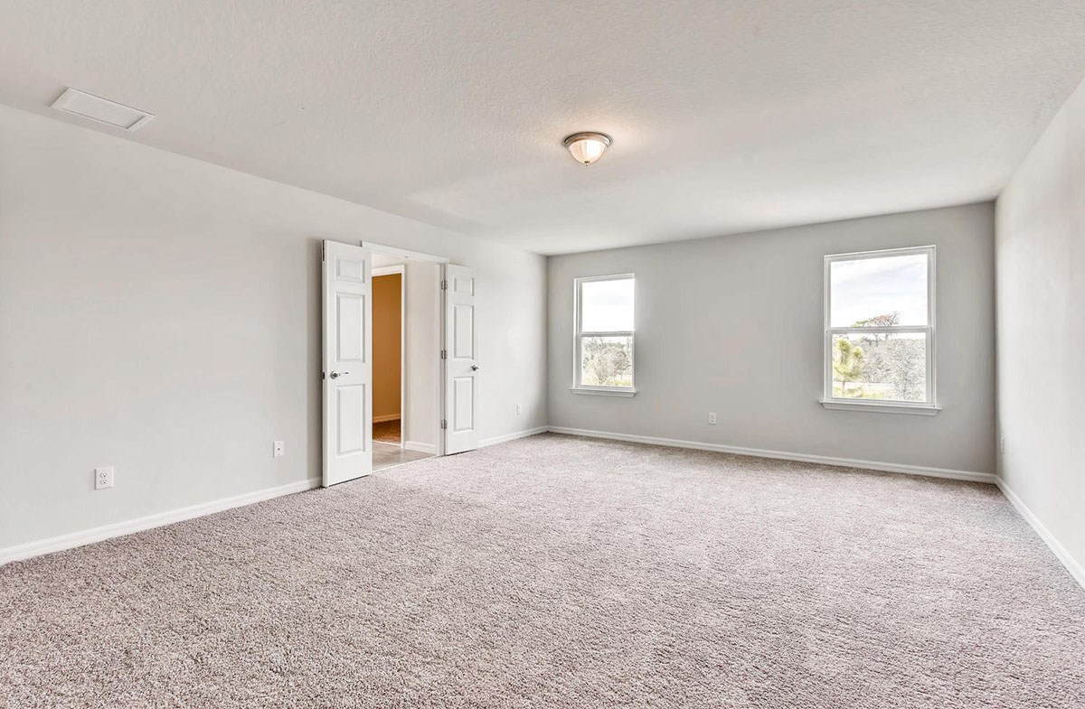 Cypress Pointe quick move-in Spacious master bedroom with backyard views