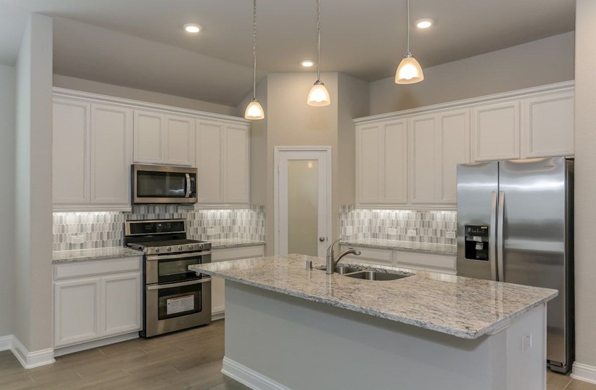 Southwinds Berkshire open kitchen with granite countertops and pendant lighting