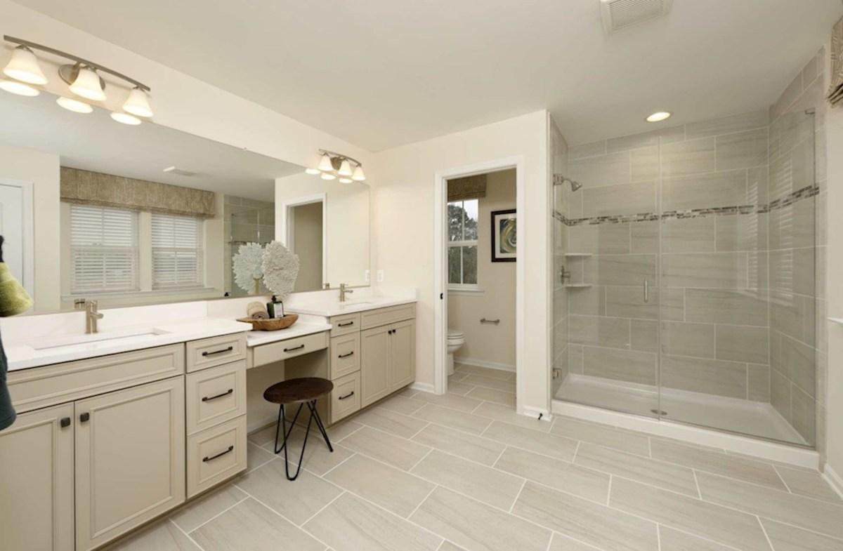 Heron's Ridge at Bayside Rehoboth Rehoboth master bathroom featuring separated vanities
