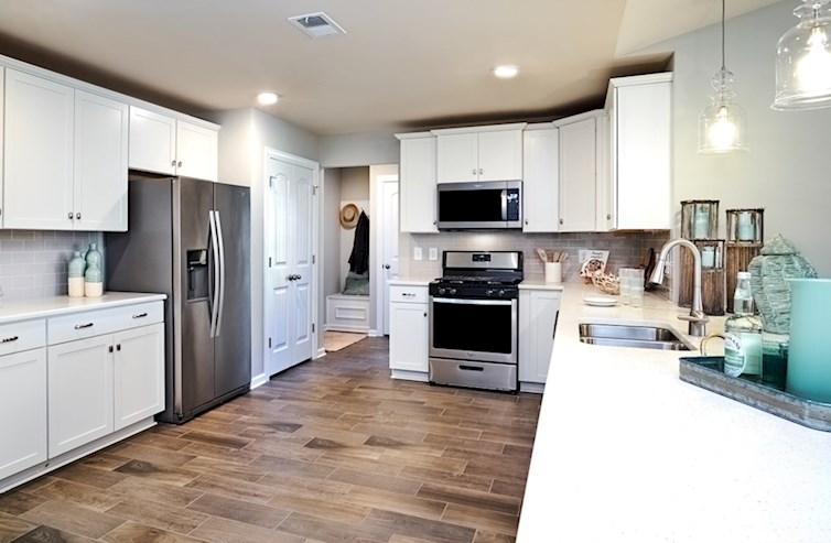 kitchen features spacious granite countertops