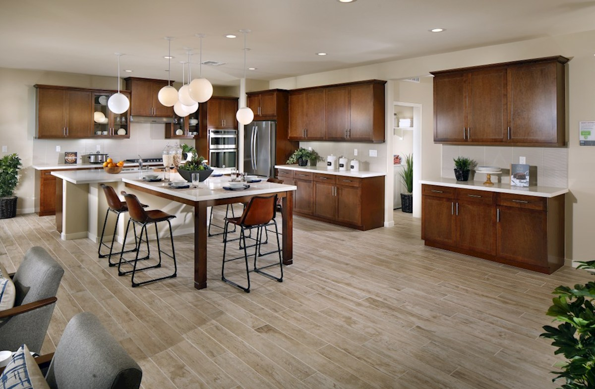 Solstice Alder Granite countertops and center island with sink provide the ideal location for food preparation