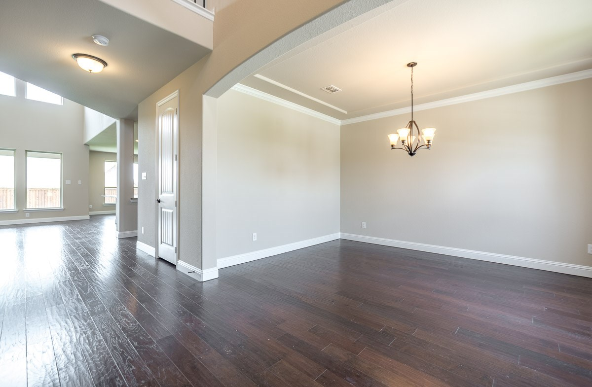 Gruene quick move-in formal dining room with wood flooring