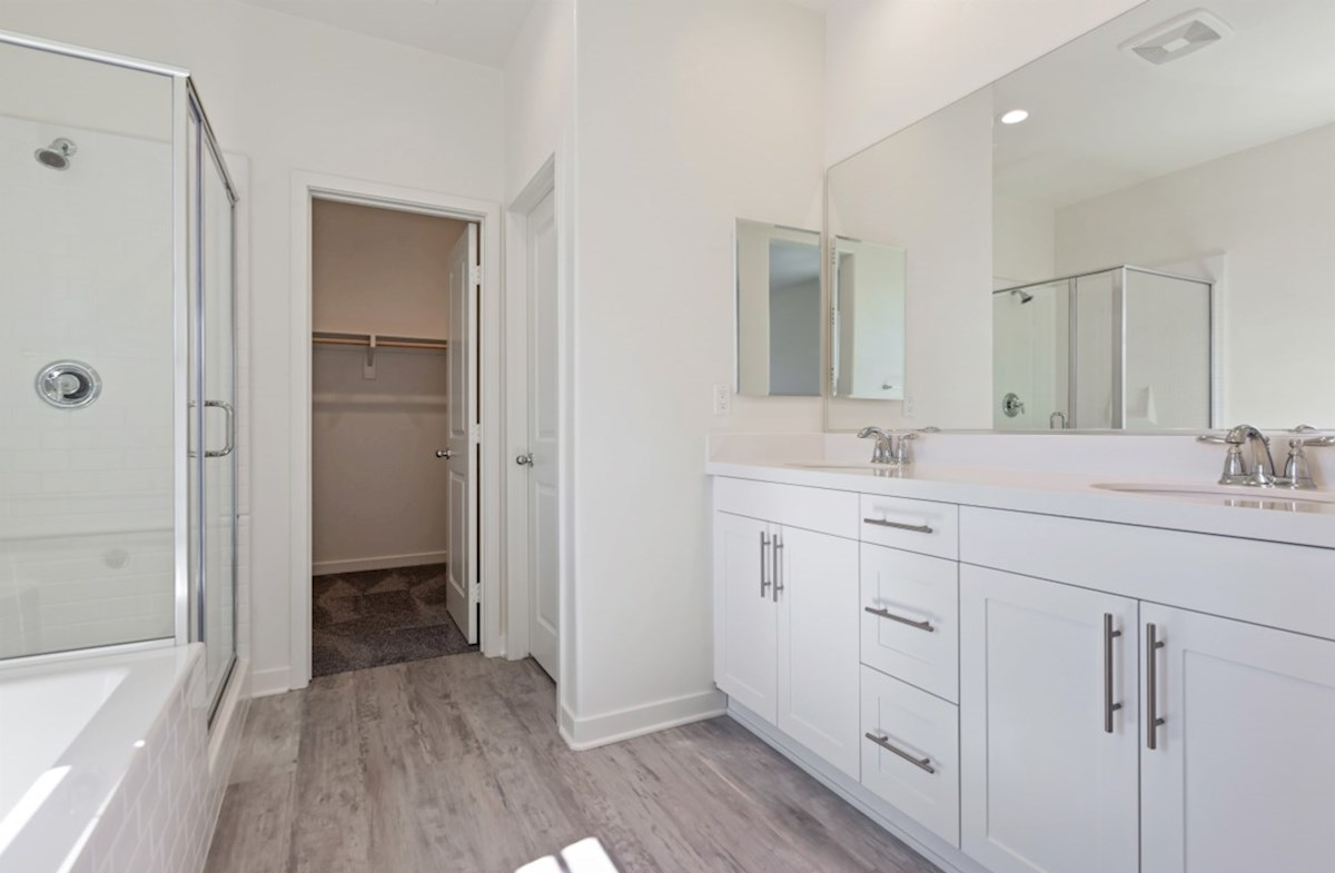 Primrose quick move-in Spa-inspired luxury abounds in the deluxe master bath, complete with separate shower and soaking tub.