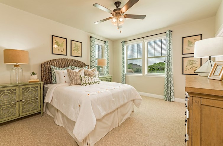 Wiltshire secondary bedroom with carpet and ceiling fan