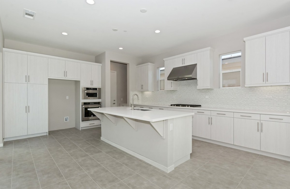 Residence 3 quick move-in Gourmet kitchen boasts an oversized island, stainless steel appliances, and stunning granite countertops