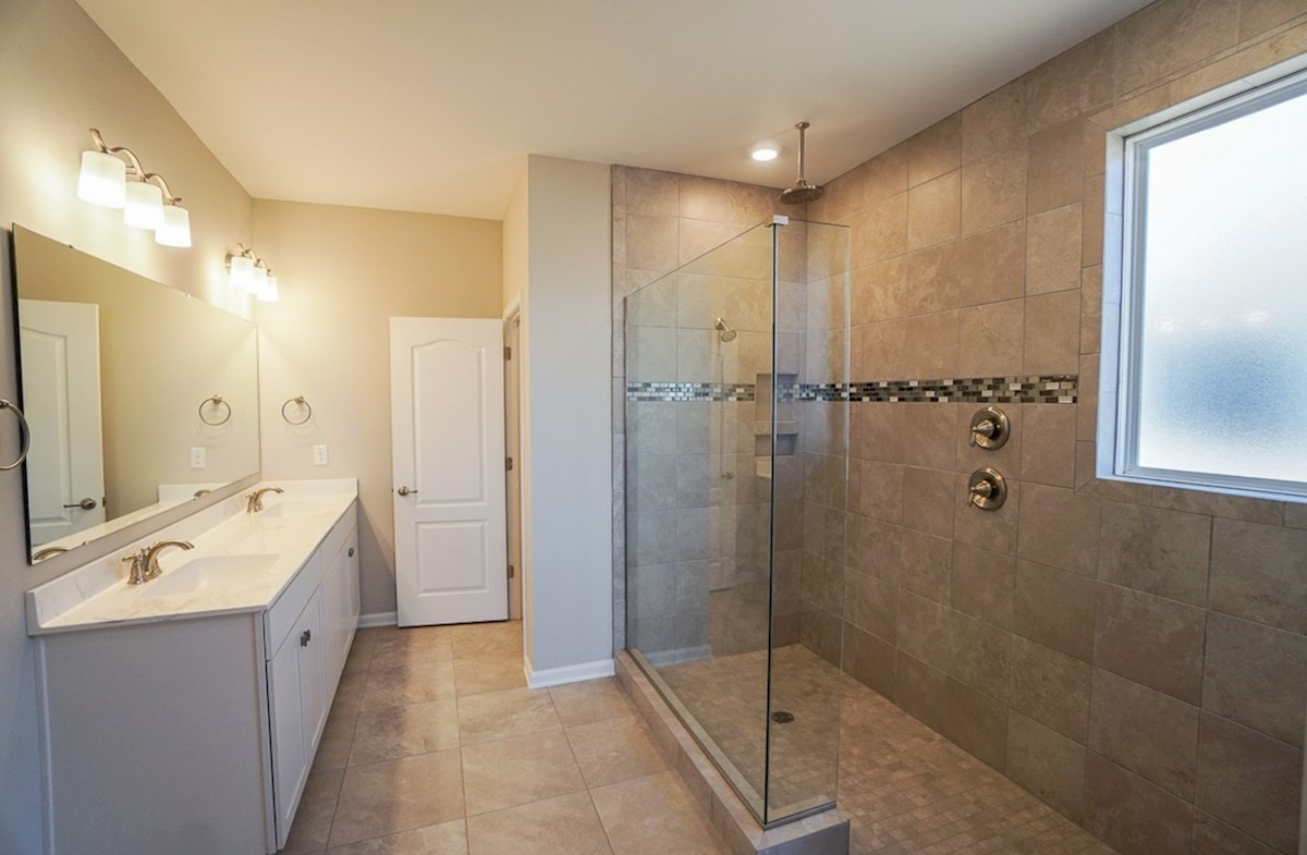 Southport quick move-in master bathroom features sports shower