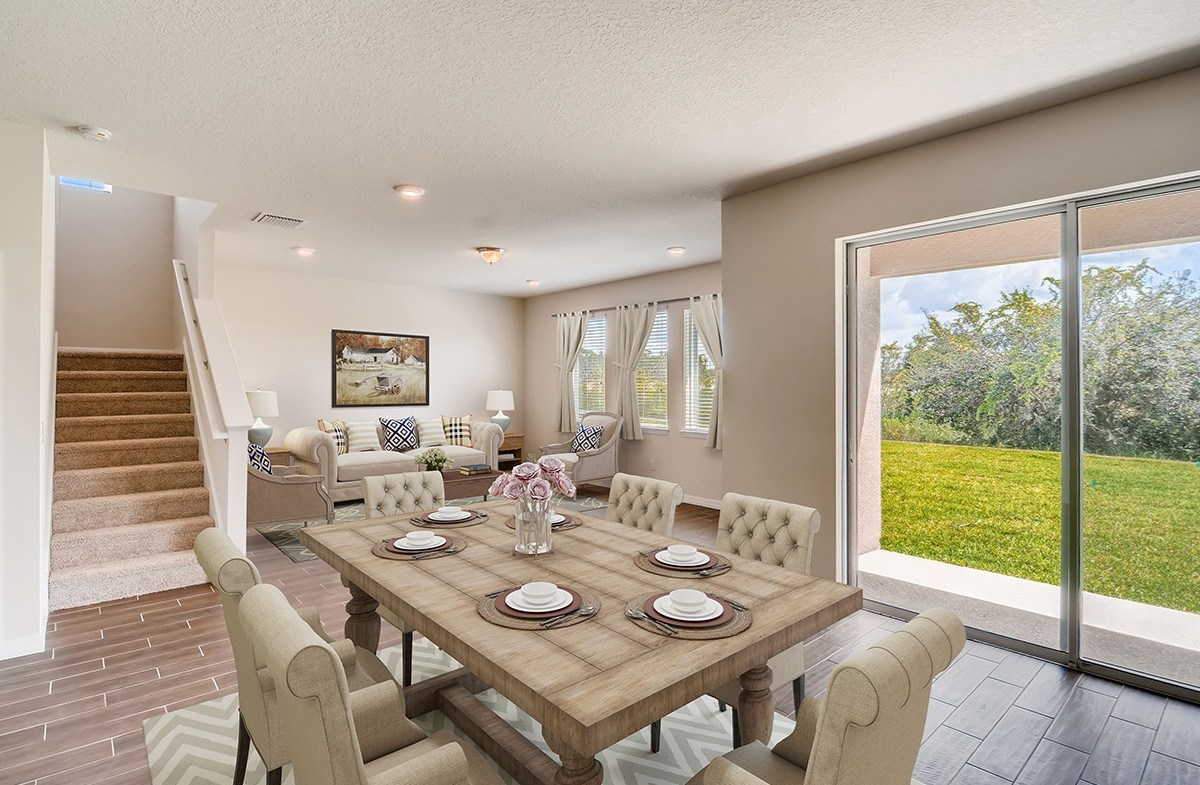 The Reserve at Pradera Sanibel Open great room and dining with large windows for natural light and backyard views