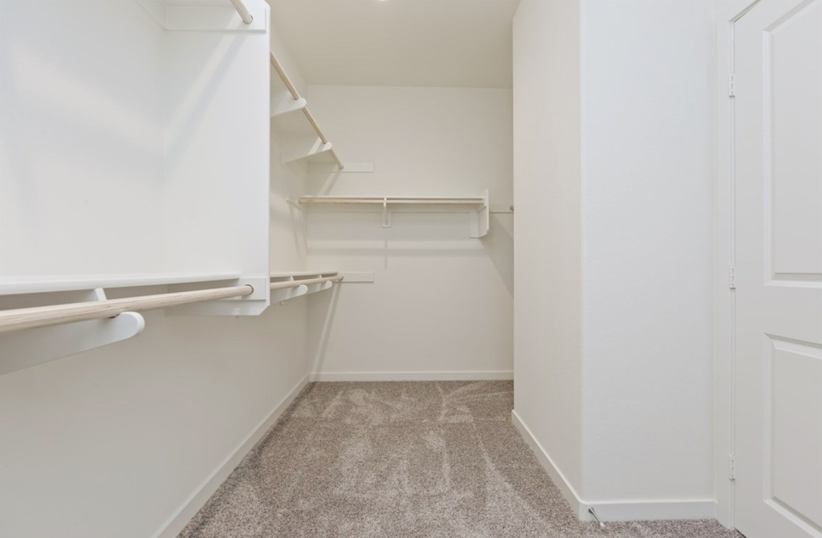 Reserve quick move-in Walk-in closet is designed for easy movement between shelves and optimal hanging and storage space