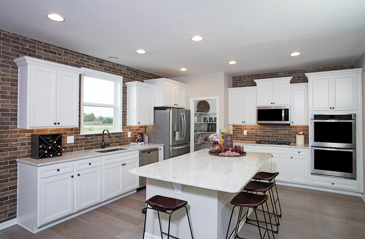 Summerland Park Shelby kitchen with white cabinets and quartz countertops