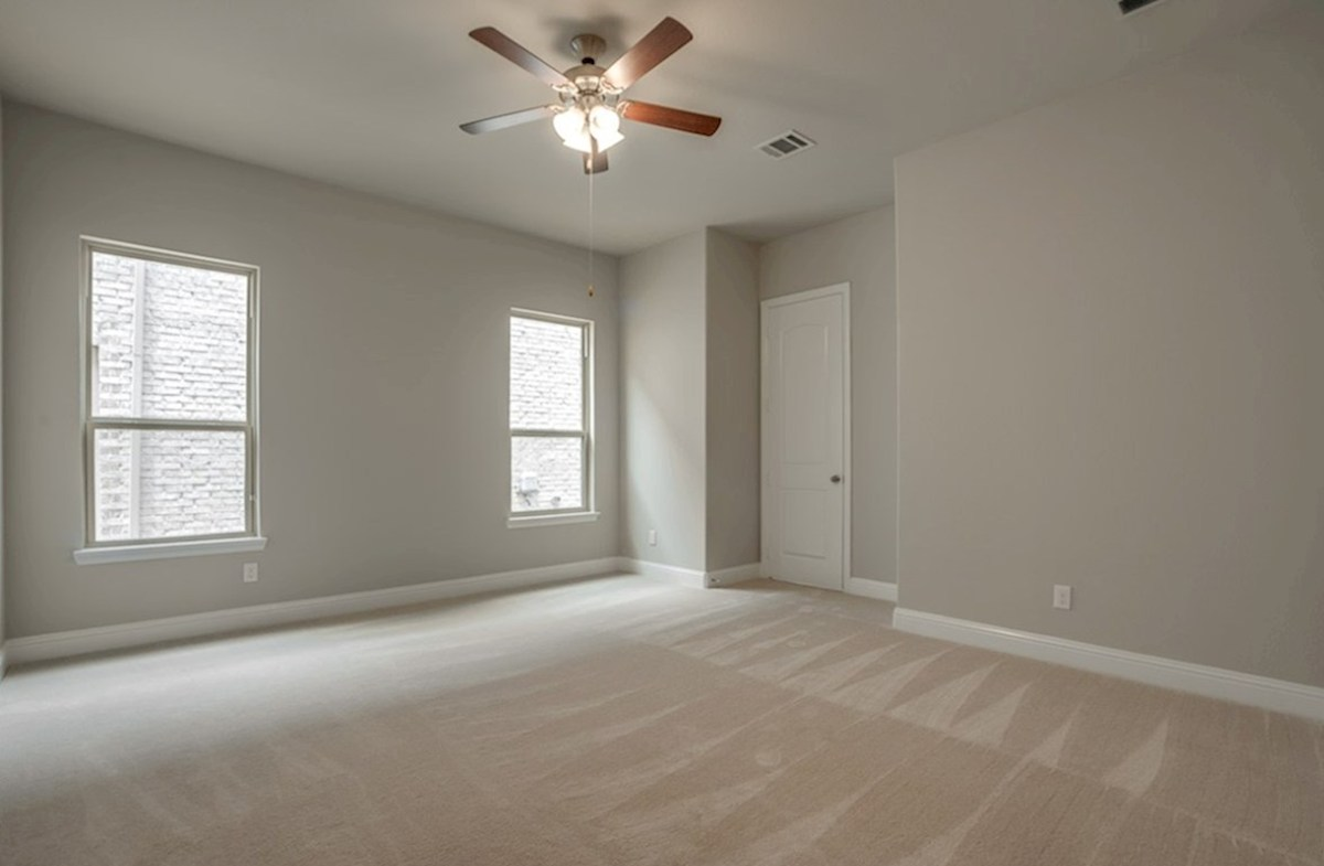 Brenham quick move-in master bedroom with carpet and ceiling fan