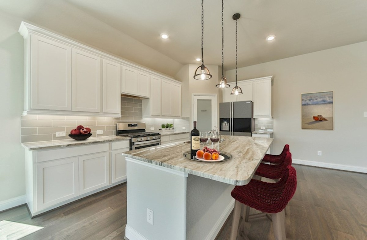 Bridgeland: Harmony Grove Cibola kitchen with granite countertops, pendant lighting and tile flooring