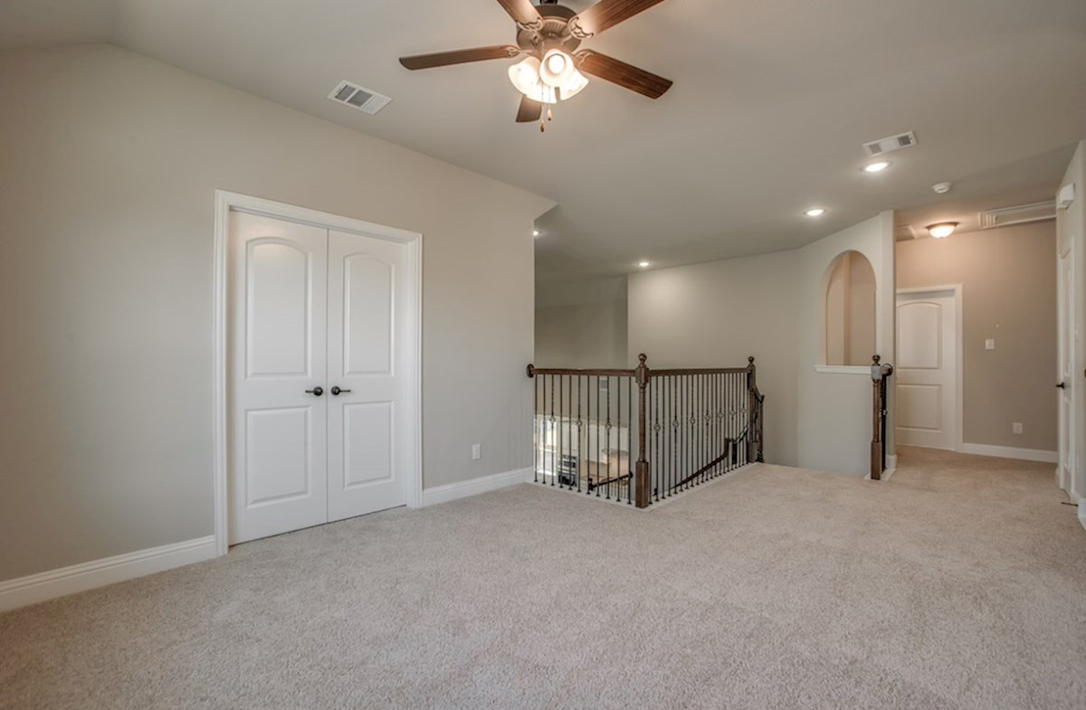 Summerfield quick move-in open loft with carpet and ceiling fan