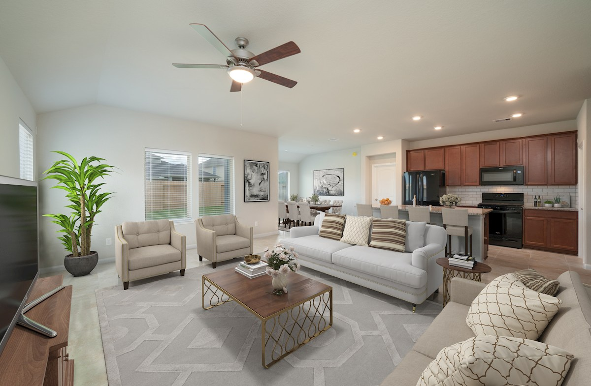 great room with ceiling fan and tile flooring