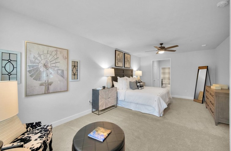 Dorset bedroom with ceiling fan and carpet